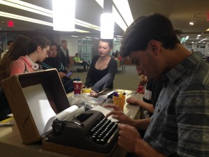 Sophomore Brendan Kiviat churned out poems on English Professor Jennifer Chang's typewriter. Chang's students were assigned projects on April 14  to promote poetry for National Poetry Month. Credit: Sara Schaeffer/WRGW News