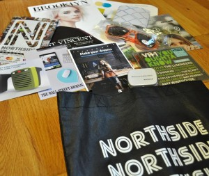 Northside Festival swag bag filled with gifts from sponsors, such as RideScout, Northside Media Group, VH1 and the Wall Street Journal.  Photo: Helen Jiang/WRGW News
